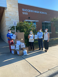 Shop LC donating face masks and hand sanitizer to Round Rock Independent School District.