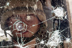 Bomb Shatters Glass, but Film Holds Dealy Shards in Tact
