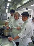Chef Olivon instructs students at L'Academie