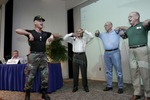 "The Health Colonel, Lt. Col. Bob Weinstein, leads a group of men in a demonstration of resistance training at South Miami Hospital's annual community health program for men.  ""ManPower: Basic Training for Better Health"" combined informative presentations about healthy nutrition and exercise with free screenings for diabetes, blood pressure, body fat, cholesterol and peripheral vascular disease."