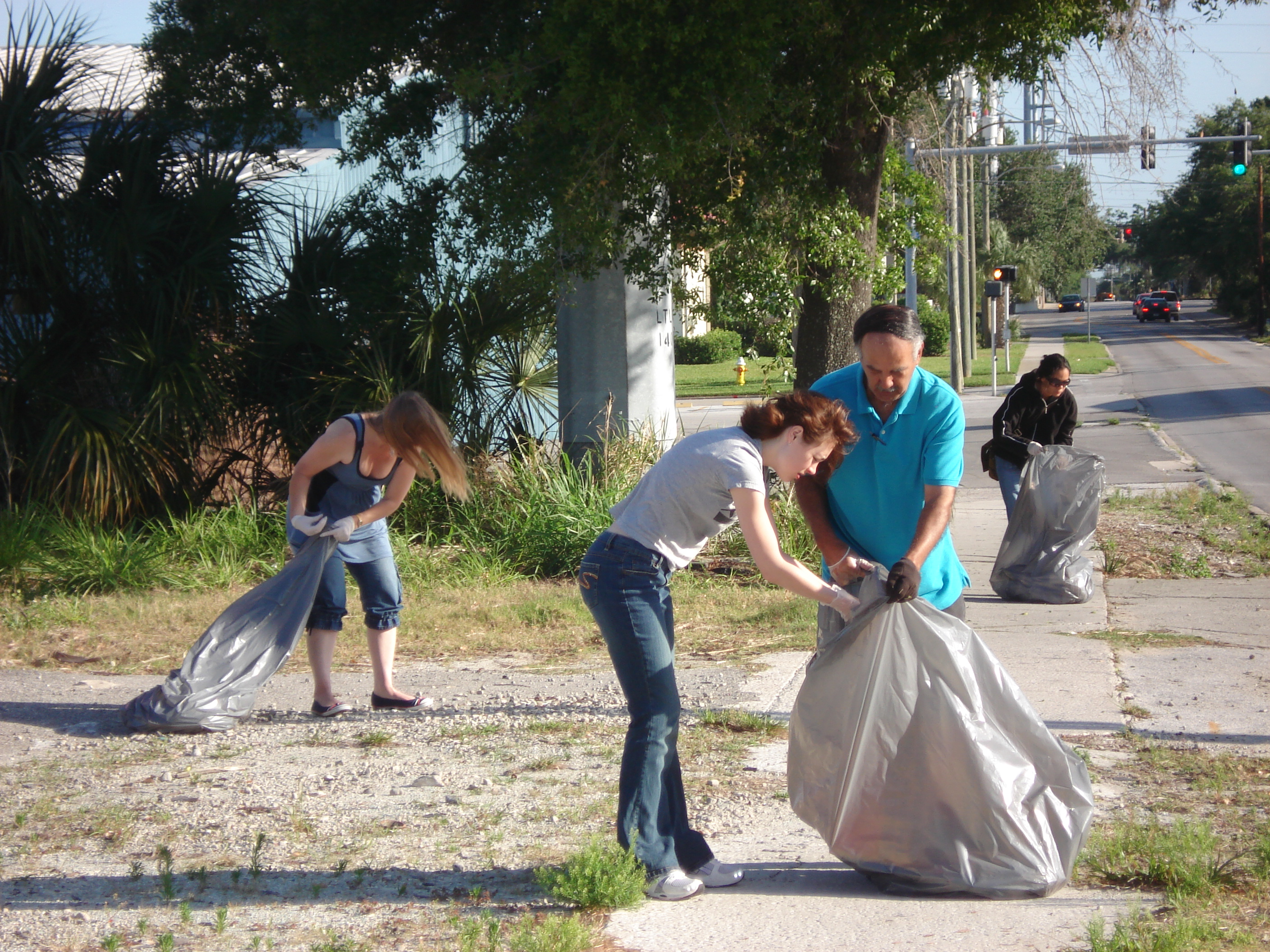 Two Young Women Picking Up Trash