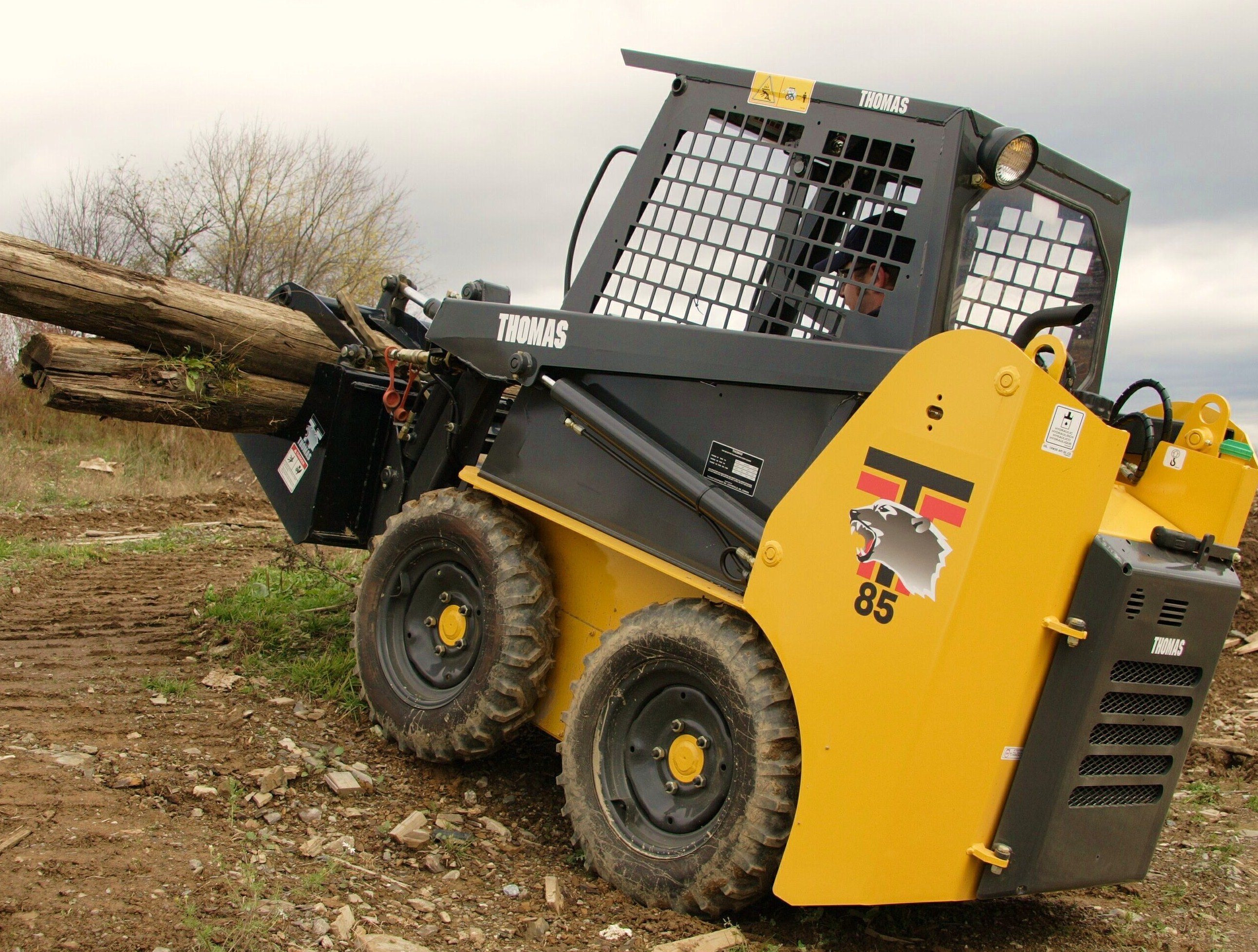 Thomas Skid Steer Loaders on the FarmThomas Equipment's Model 85  http://www.thomasloaders.com[Skid Steer] Loader combines strength and  agility on the farm.