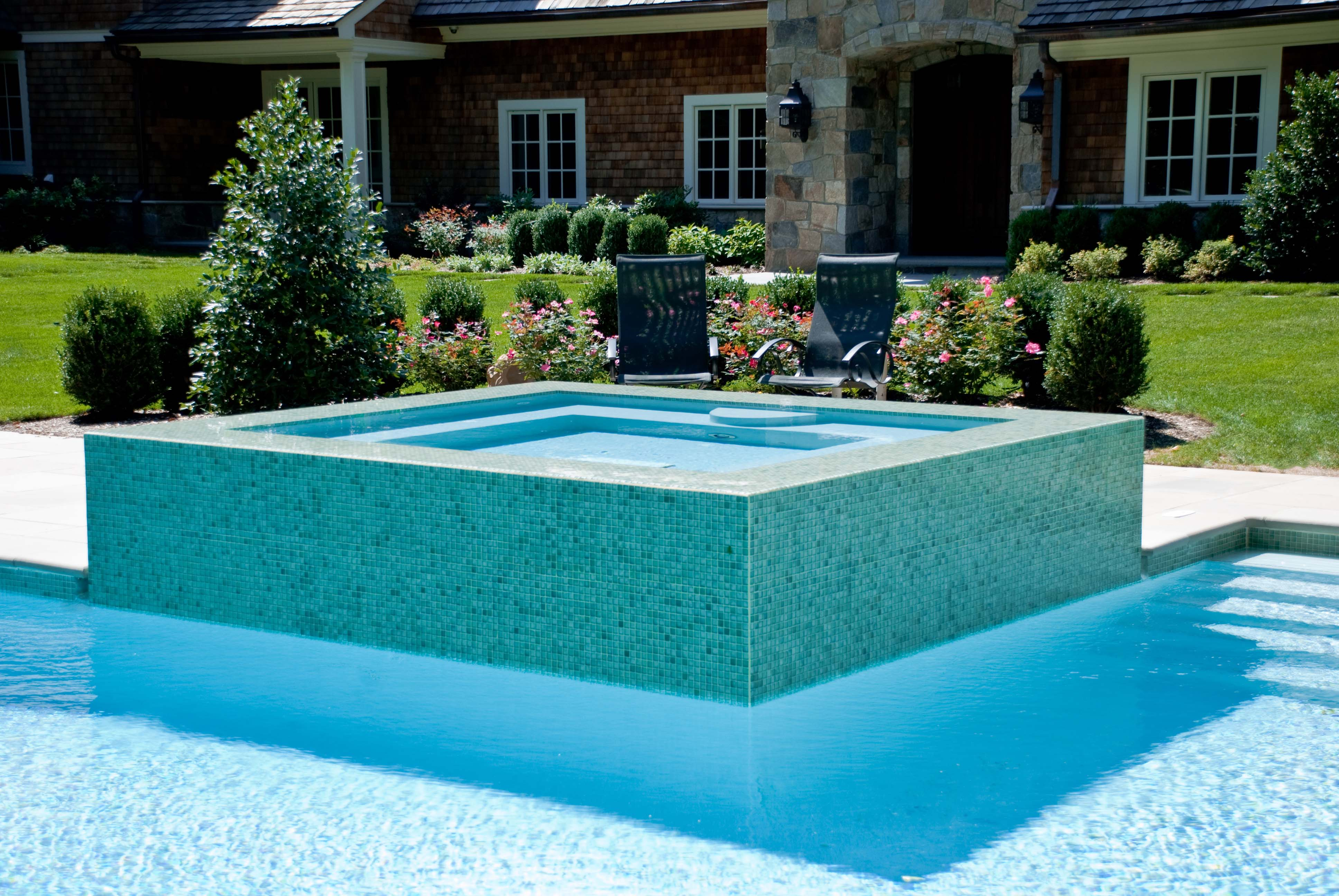 Glass tile swimming pool designs earn new jersey based for Spa swimming pool