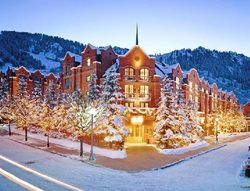 The St. Regis Aspen Resort lit up at night in the winter