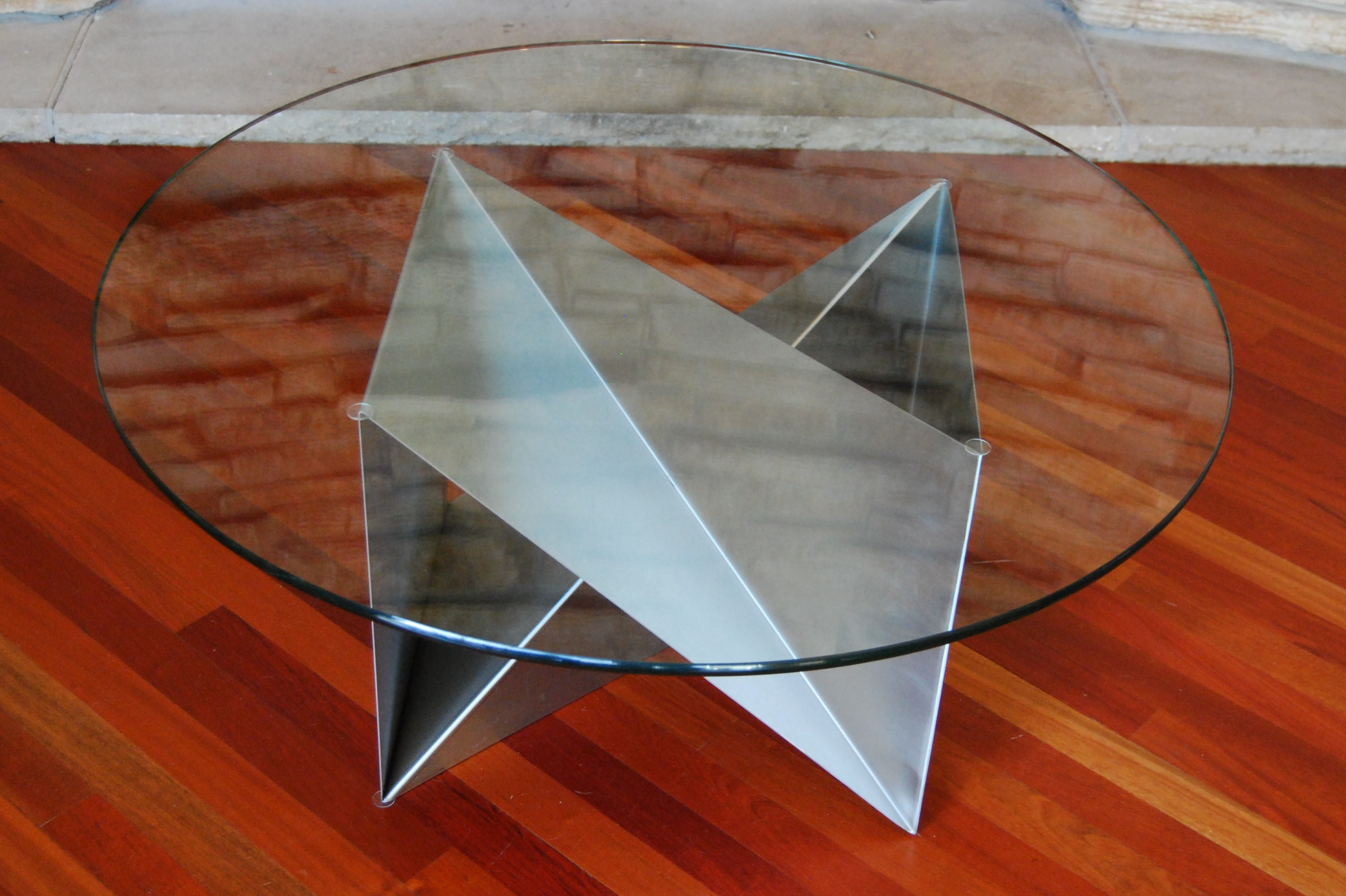Coffee Tabletb161618 Laying On Its Side With A 36 Diameter Round Glass Top Stainless Steel