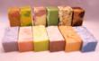 An array of all-natural creamy goat milk soaps available online at GoatMilkStuff.com