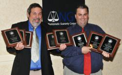 Coin expert Michael Fuljenz, and Jerry Jordan, Managing Editor of the Examiner newspaper in Beaumont, Texas, hold their respective 8 NLG awards following the NLG Bash in Boston.