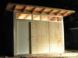 Nystad STUDIO SHED® at night, unpainted