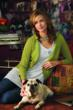 cabi one button cardi and cluster tunic on woman with dog