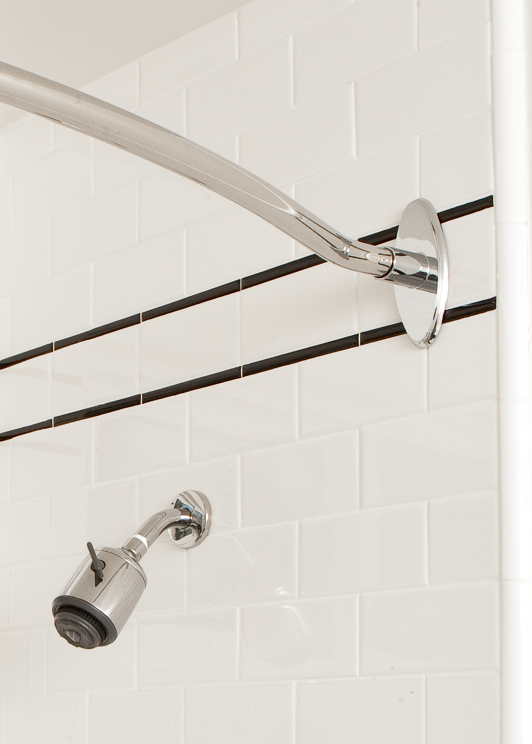 Motiv® Curved Shower Rod Creates 6 More Inches of Shower Space