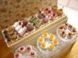 Dollhouse miniature 1/12 scale display shelf with elegant artisan cakes. Entirely handcrafted, this measures 6.5cm by 5.3cm.