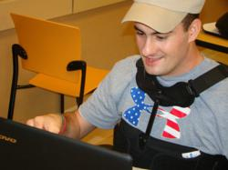 Wounded hero receives laptop from Project Valour-IT