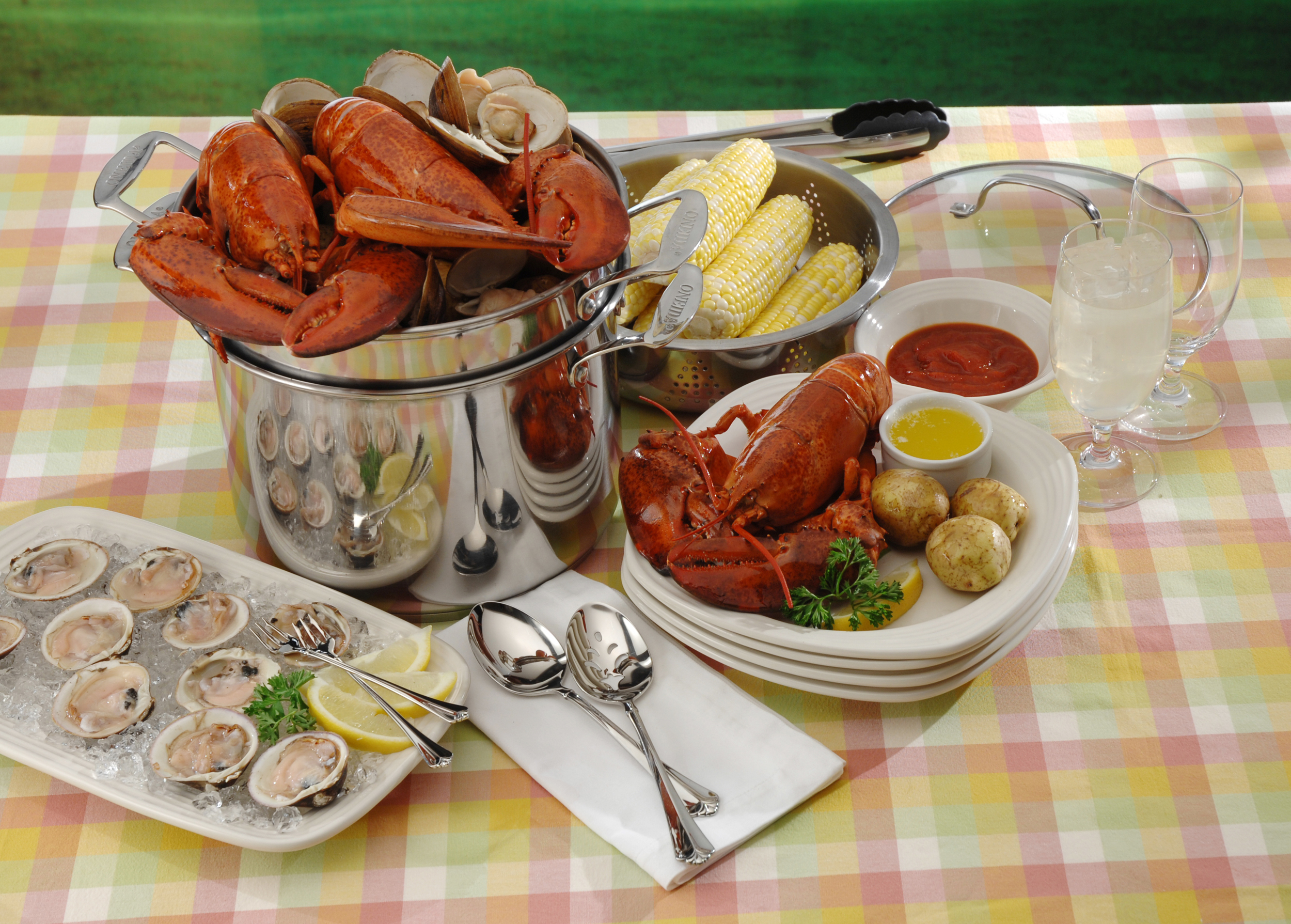 Festive seafood boil featured on Oneida Culinaria dinnerware with Juilliard flatware and stainless multi cooker.Seafood picnic ... & Ten Tips on Eco Friendly Dining and Entertaining from Oneida Ltd.