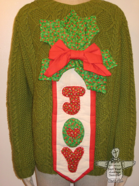 an ugly christmas sweater thats full of joythis is an example of one of the hundreds of ugly christmas sweaters in the not your average sweater eshop