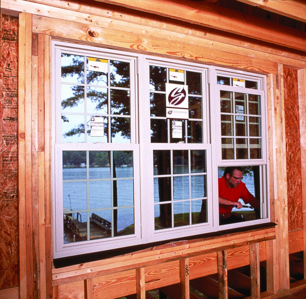 simonton replacement windows white vinyl triple mulled unit of simonton windows being secured on home windows ranks highest in customer satisfaction with