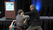 Author Speaker Richard London teaching a wheelchair patient to break a board
