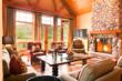 Living room featuring river rock fireplace at Woody Creek mountain estate absolute auction.