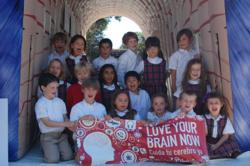 A group of students at All Saints' Carden Academy pose for their photo inside the giant inflatable brain
