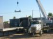 Transferring containers from a rail flatcar to a truck at MHF's transload facility in Parker, AZ.