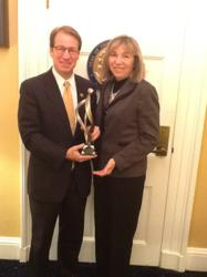 Cong. Peter Roskam receives AMRPA Chairman's Award from Kathleen Yosko
