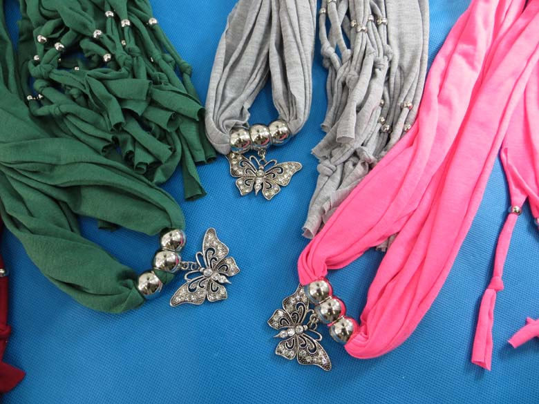 Clothing supplier apparel sarong wholesalesarong announces the wholesalesarong wholesale scarf pendant jewelryscarf with jewelry aloadofball Images