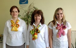 Elisabeth Molnar (center) and the team of Hotel Link Solutions Romania