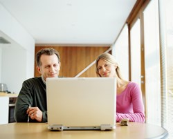 Couple checking their credit online
