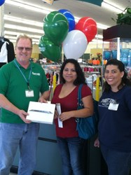VIP Monica being awarded her prizes at Thrift Town Fort Worth