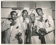 The Ink Spots, a vocal group that helped define the musical genre that led to rhythm and blues, and rock and roll.