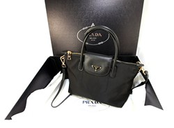 8ae2dc97d505 Celebrate Christmas With Prada Handbags And Nylon Bags