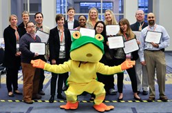 The 2013 HUG Super Forum  award winners with Higher Logic's Floyd Frog