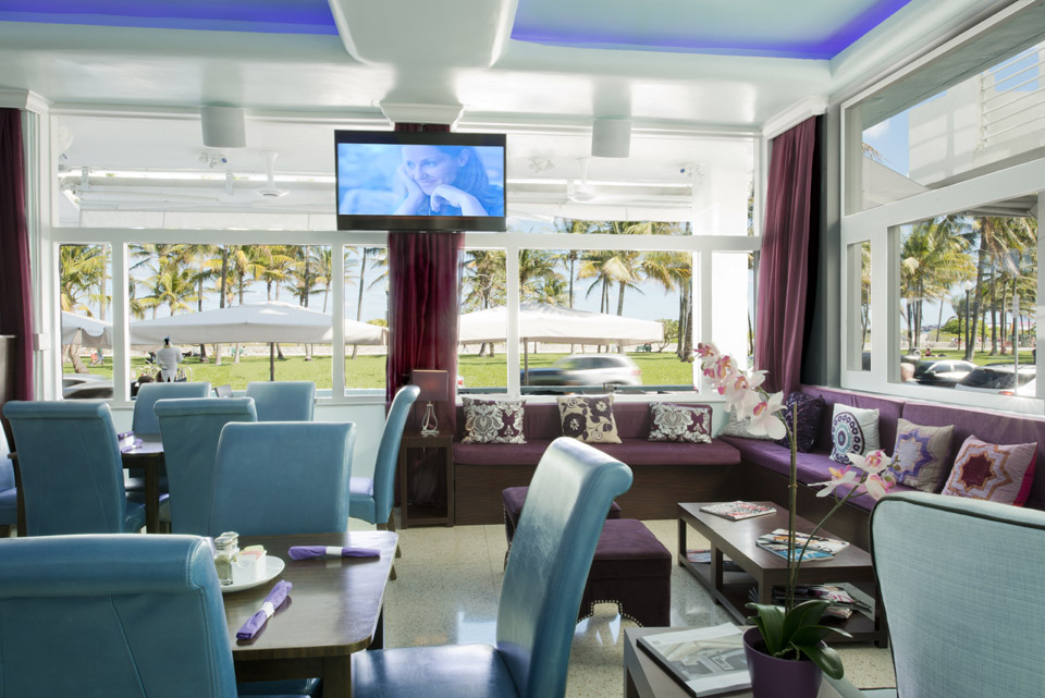 The Purple Penguin Cafe At Hotel Offers Indoor And Outdoor Seating