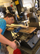 Sean Bowers builds the neck for a cigar box guitar in the Rocklin High School engineering technology lab.