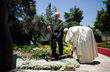 "Pope Francis plants a symbolic olive tree on Mount of Olives during his ""pilgrimage of prayer"""