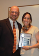2014 Sciera Service Award recipient, Kristy Hart (right), recognized by NYSATA Awards Chair, Andy Smith.
