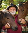 Mustang expert Fred Woehl tames and trains rescued wild mustangs during the National Harvest & Cowboy Festival.