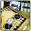 "ModernTribe took the ""Light, Joy, Latkes"" design and made plates, utensils, greeting cards, cupcake toppers and more."