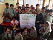 School children in Pakistan display a friendship sign from Kids for Peace USA