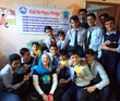 Kids for Peace Co-Founder Jill McManigal with school children in Pakistan. December 2014.