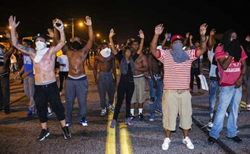 Photo showing protesters using the Hands Up gesture in Ferguson, Missouri, August 2014, from http://interoccupy.net/blog/hands-up-dont-shoot-demands/