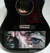 Artist Zhenya Gershman created a special portrait of Bob Dylan painted on a Caballero guitar that will be signed by Dylan and all performers at the tribute concert, then auctioned off at the benefit.