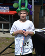 "Glastonbury's Evan Lionberger, 9, was the top 5k male finisher in the ""age 9 and under"" group."