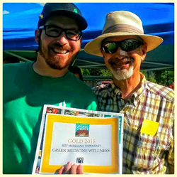 Brian Sullivan of The Green Joint, accepting the Gold Award from Michael Bennett, Publisher of The Post Independent