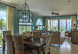 Open concept dining and living spaces with beautiful decor.