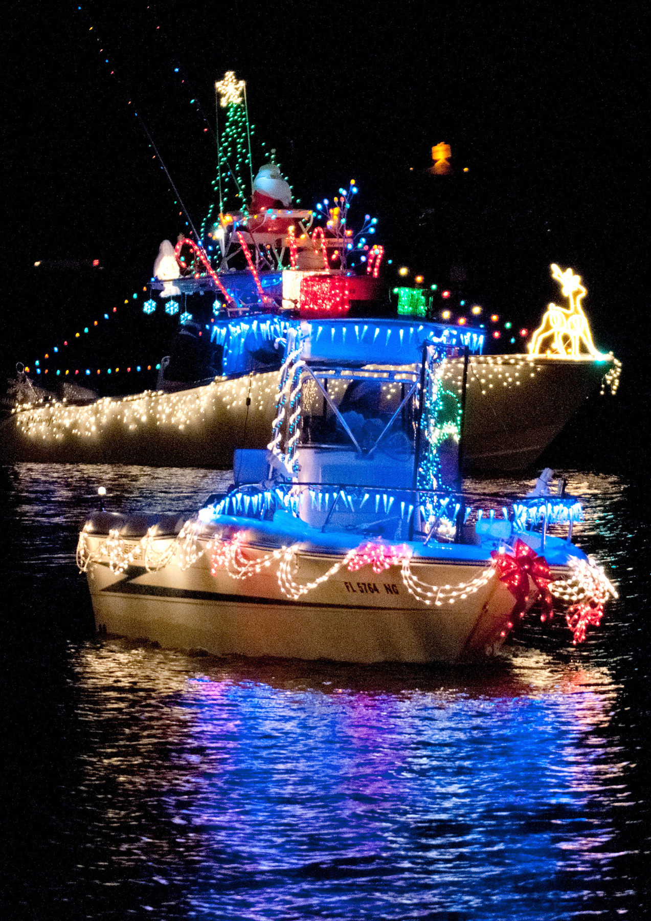 the lighted boat parade on pensacola beach