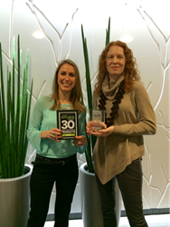 Samantha Hart presents 30 Most Innovative Products Award to Erica Moir, Vice President Marketing and New Product Development, for the Siena™ Freestanding Bathtub Design in Las Vegas, Nevada