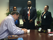 David A. Johnson, co-founder of St. Croix-based consulting firm Cane Bay Partners VI, signs a $25,000 donation to the Gov. Juan F. Luis Hospital on Wednesday, completing a $50,000 donation to the Women's and Children's Division.