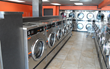 Row of New Dexter Coin-Op Laundry Machines At Renovated Rubalcaba Bros Coin Laundry