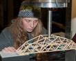 A student setting their bridge to be tested at the Colorado High School Bridge Building Contest.