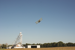 A small airplane is used for aerial application of cover crops on Schmidt Farms.